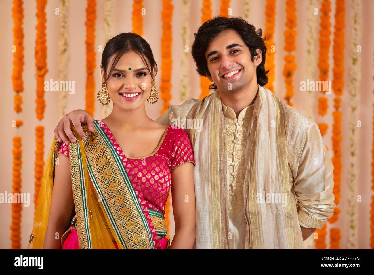 Young Couple Happily Posing Together In Traditional Wear For Diwali Stock Photo Alamy