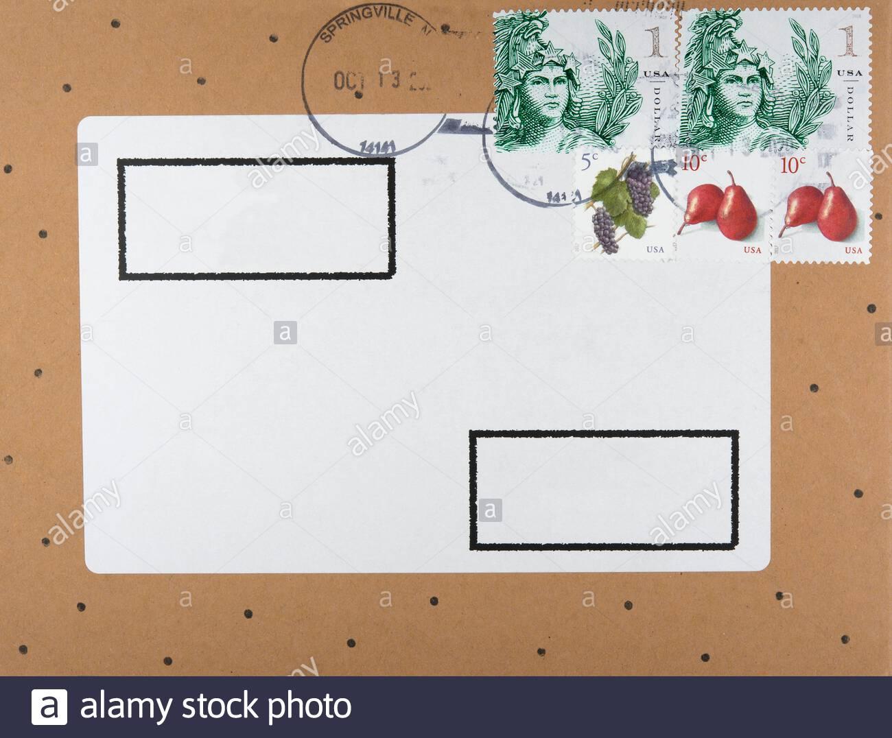 briefumschlag envelope usa amerika america briefmarken stamps springville gestempelt used früchte fruits frau gesicht face punkte eagle adler braun Stock Photo