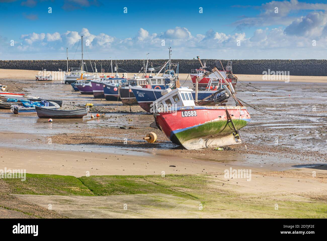 Fishing boats in Folkestone harbour  when the tide is out. Stock Photo