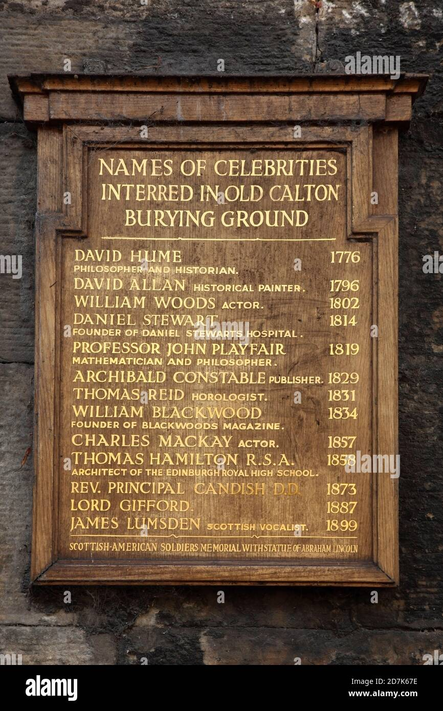 Plaque listing well-known people buried in Old Calton Burial Ground, Edinburgh, Scotland. Stock Photo