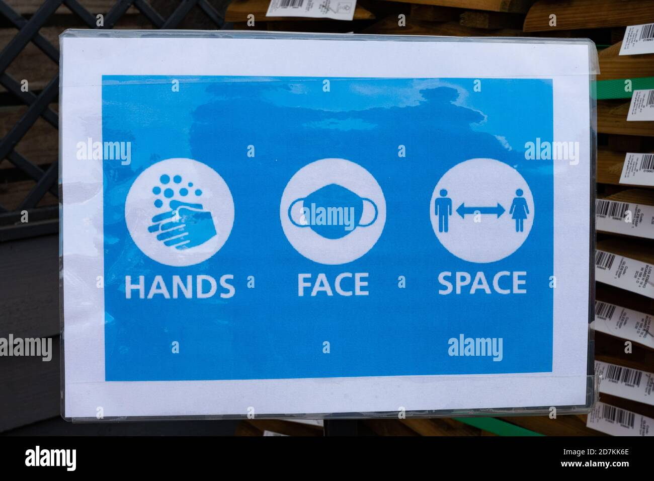 Hands Face Space slogan on notice or poster at a garden centre during the coronavirus covid-19 pandemic, October 2020 Stock Photo