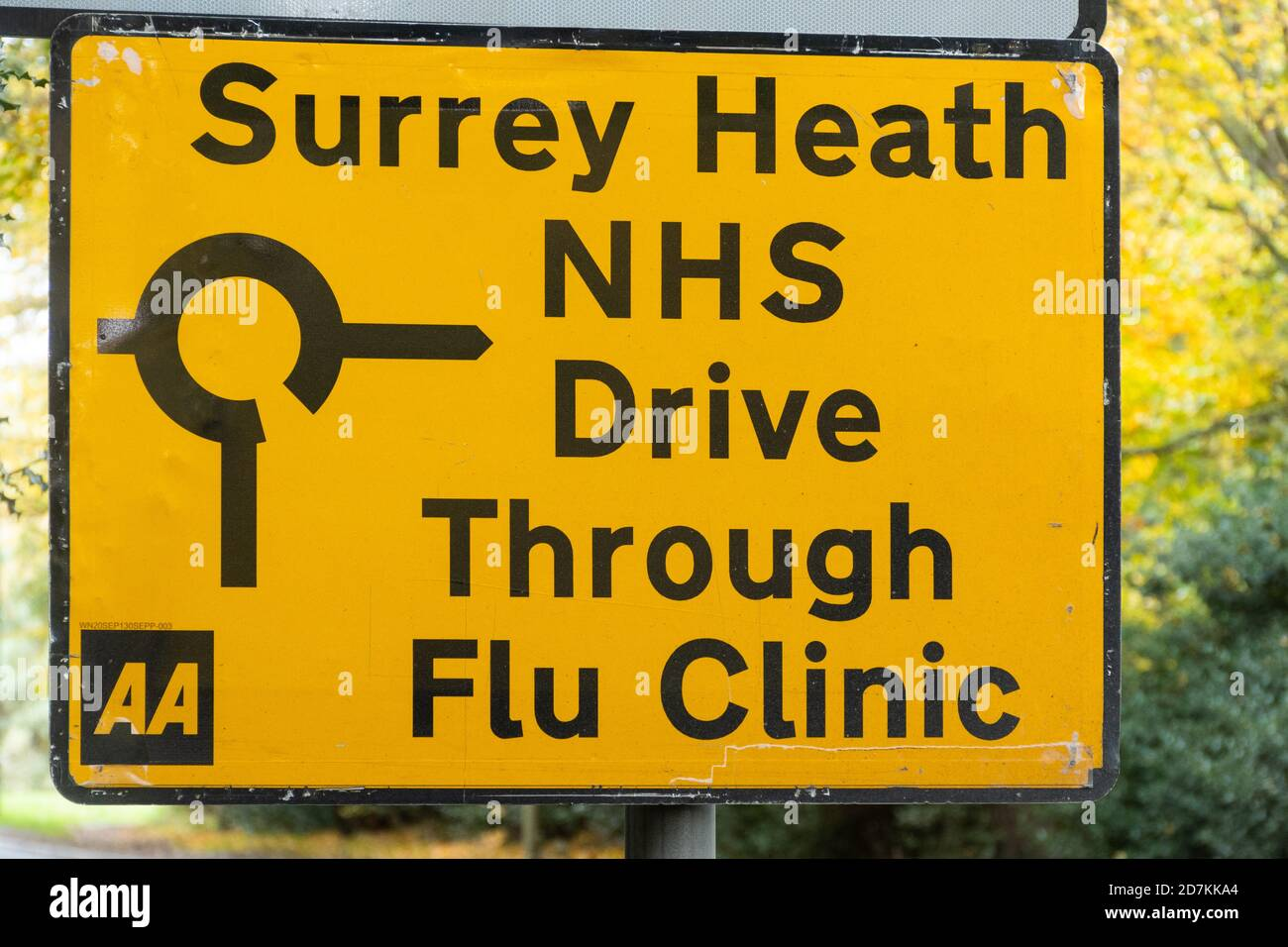 Road sign to an NHS drive through flu clinic providing influenza jabs vaccinations immunizations, Surrey, UK Stock Photo
