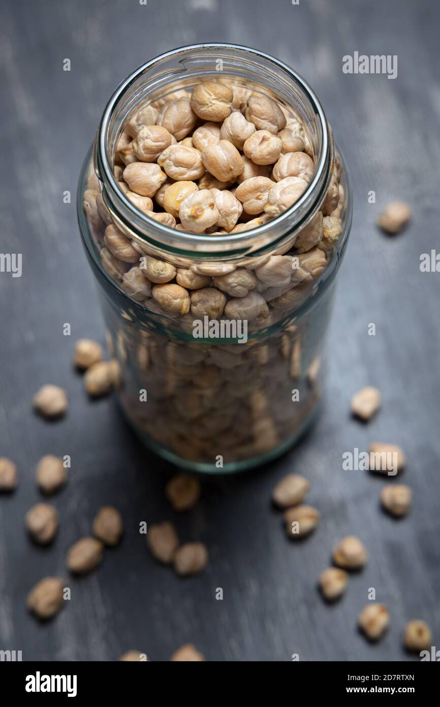 Glass jar with chickpeas placed on a tabletop. Eco friendly concept Stock Photo
