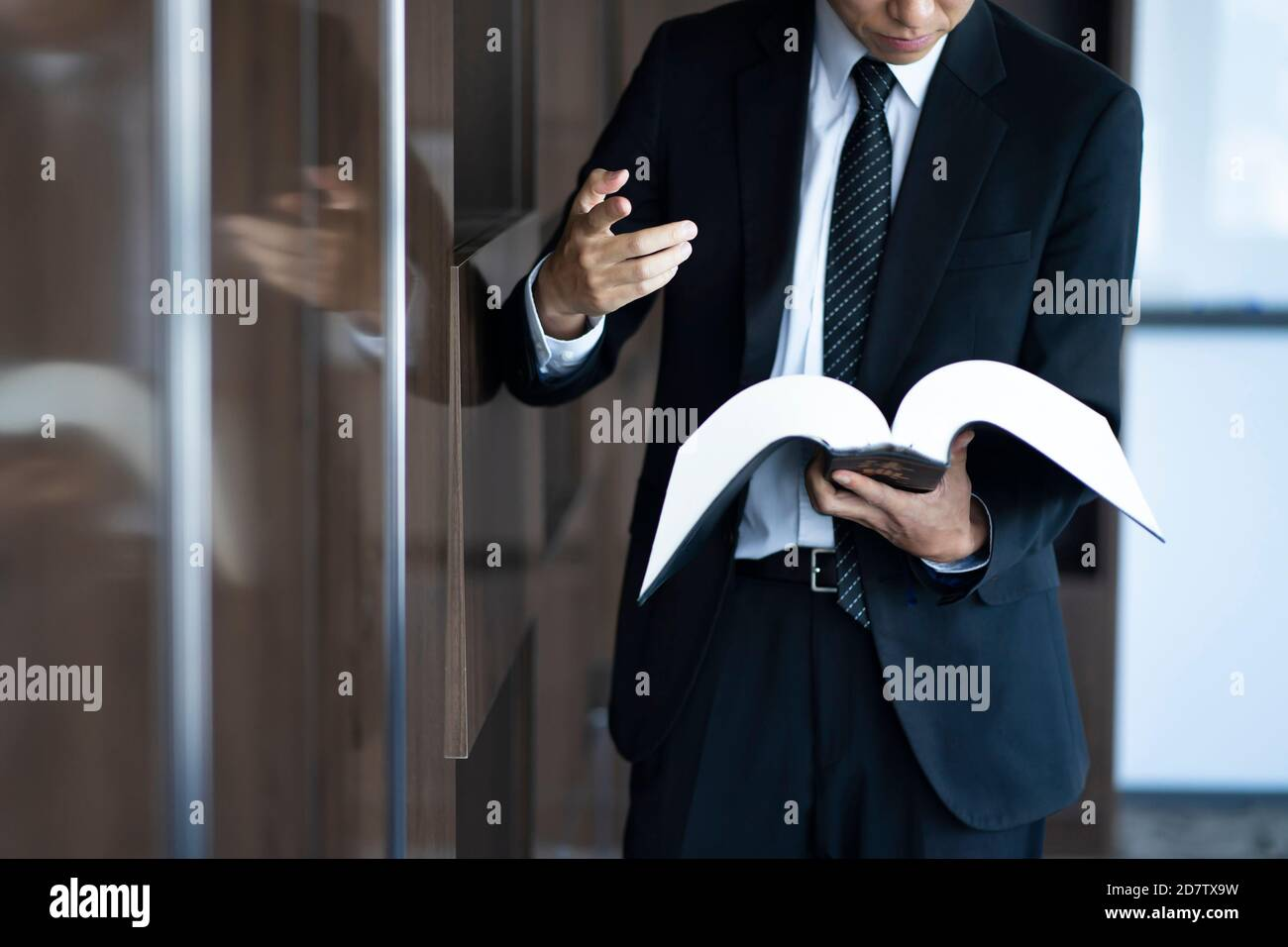 Cropped image of lawyer reading law book Stock Photo
