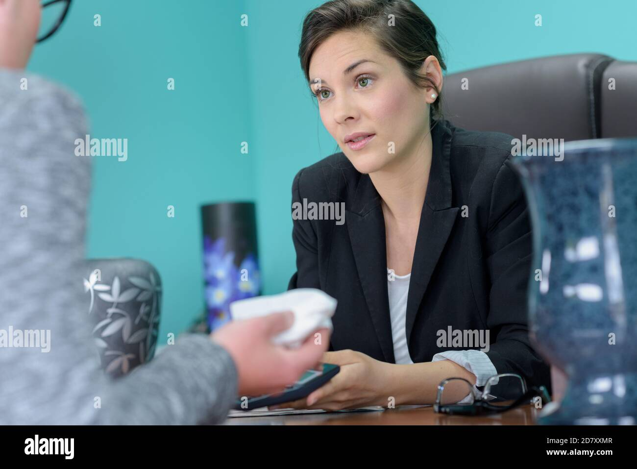 funeral office manager talking to customer Stock Photo