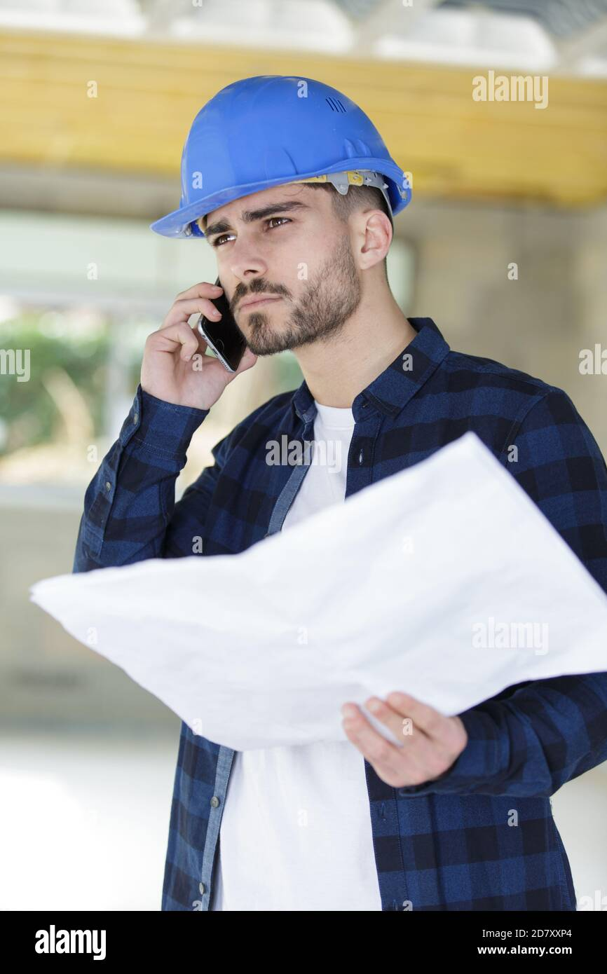 architect checking a house project and having a phone call Stock Photo