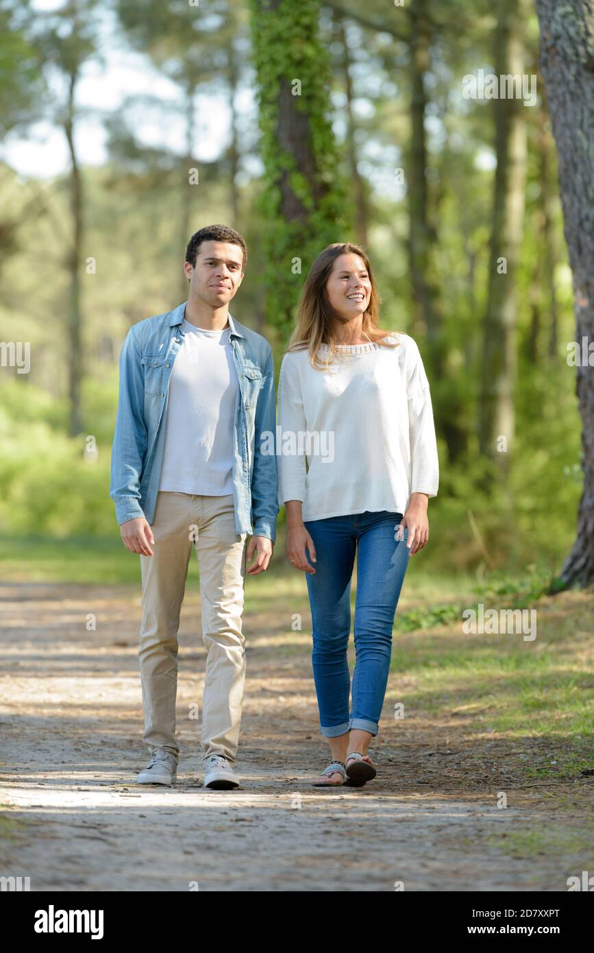 couple on a walk in forest Stock Photo