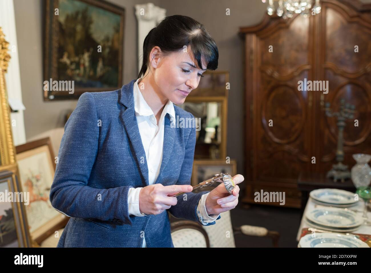 woman is shopping in the antique store Stock Photo
