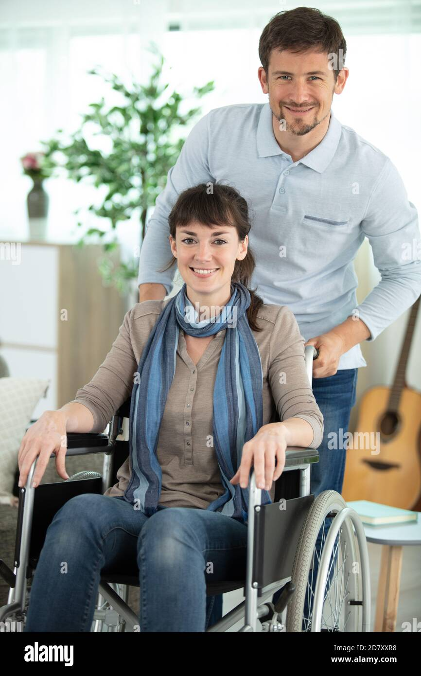 woman in wheelchair with handsome man Stock Photo