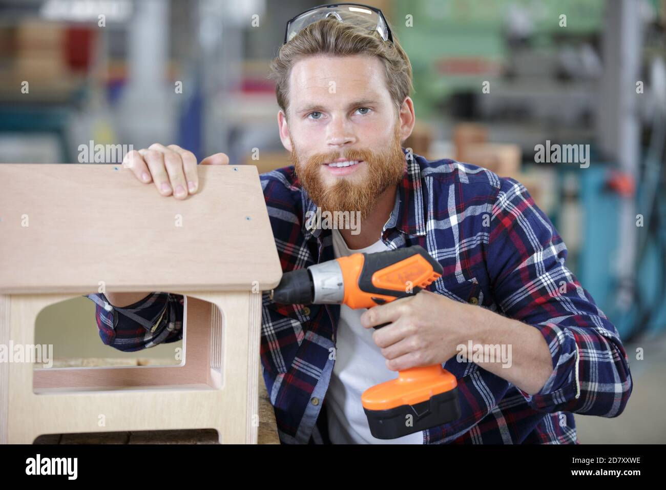 worker uses a with a drill Stock Photo