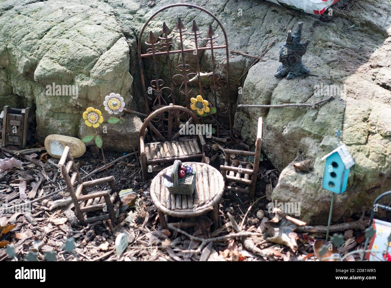Miniature hobbitlike outdoor dining area with gate to inner tunnel. Downers Grove Illinois IL USA Stock Photo