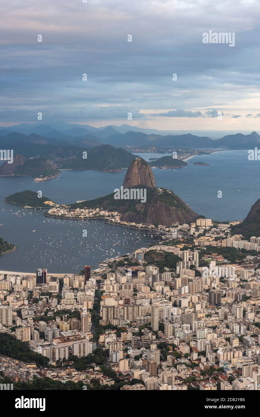 Beautiful view to Christ the Redeemer Statue to Sugar Loaf Mountain and city, Tijuca Forest, Rio de Janeiro, Brazil Stock Photo
