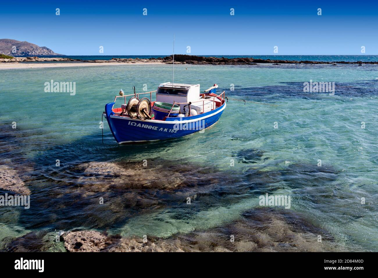 Traditional Greek fishing boat moored on the beautiful island of Elafonisi in Crete Greece Stock Photo
