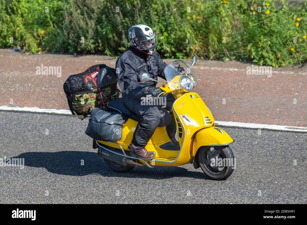 Yellow Vespa Scooter Rider Two Wheeled Transport Motorcycles Vehicle Roads Motorbikes Bike Riders Motoring In Chorley Uk Stock Photo Alamy