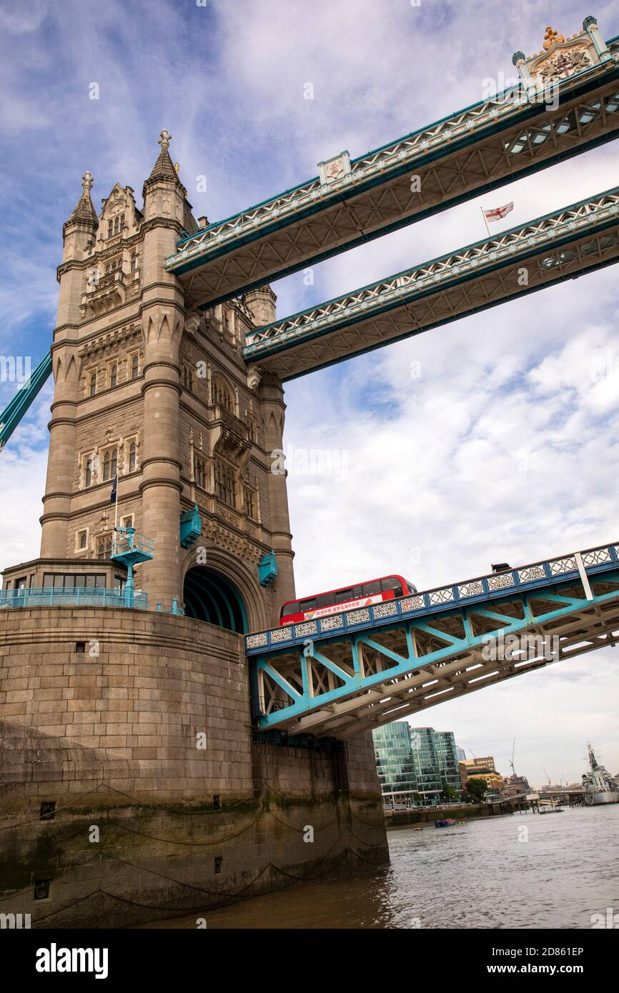 UK, London, Tower Bridge, view up from boat passing below tilting deck with London bus crossing Stock Photo