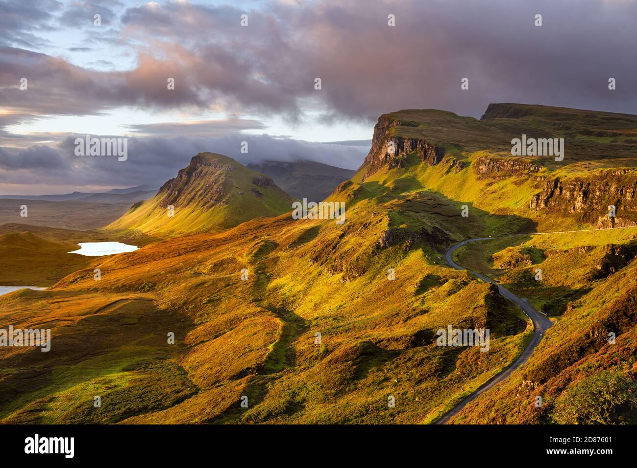 Morning light at The Quiraing on the beautiful Scottish Isle of Skye with winding road. Stock Photo