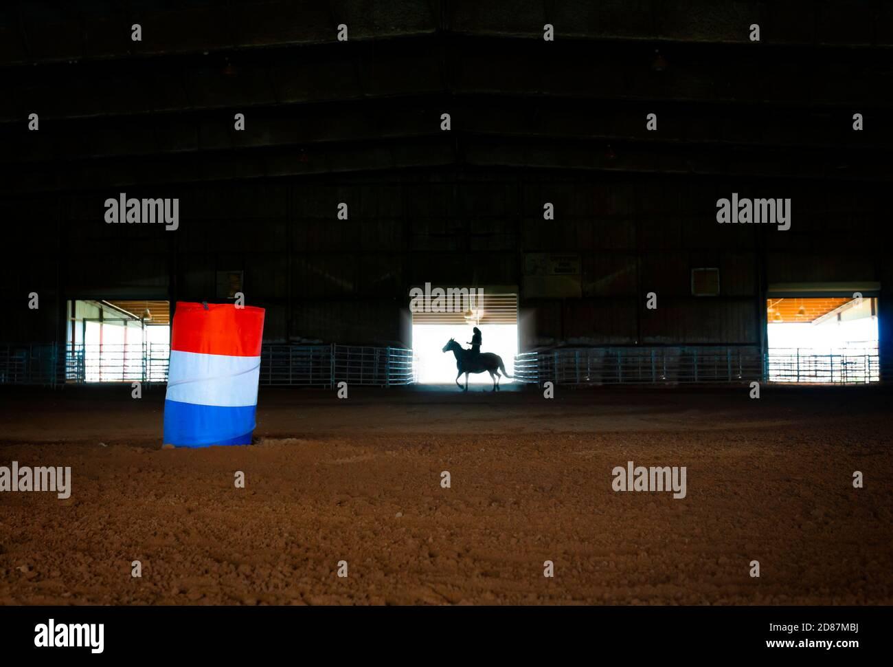 Woman On Horseback Silhouette In Barrel Racing Arena Stock Photo Alamy