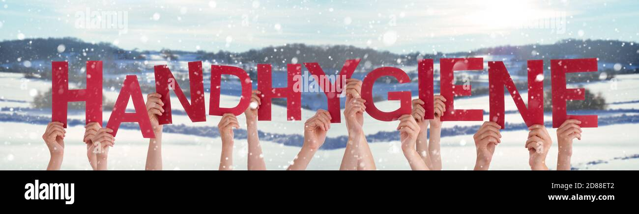 Hands Holding Word Handhygiene Means Hand Hygiene, Snowy Winter Background Stock Photo