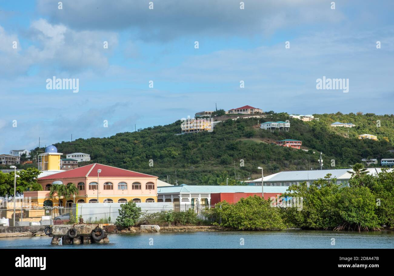 Christiansted, St. Croix, US Virgin Islands-March 8, 2020: View of rolling hill range with housing and Gallow's Bay buildings on St. Croix in the USVI Stock Photo