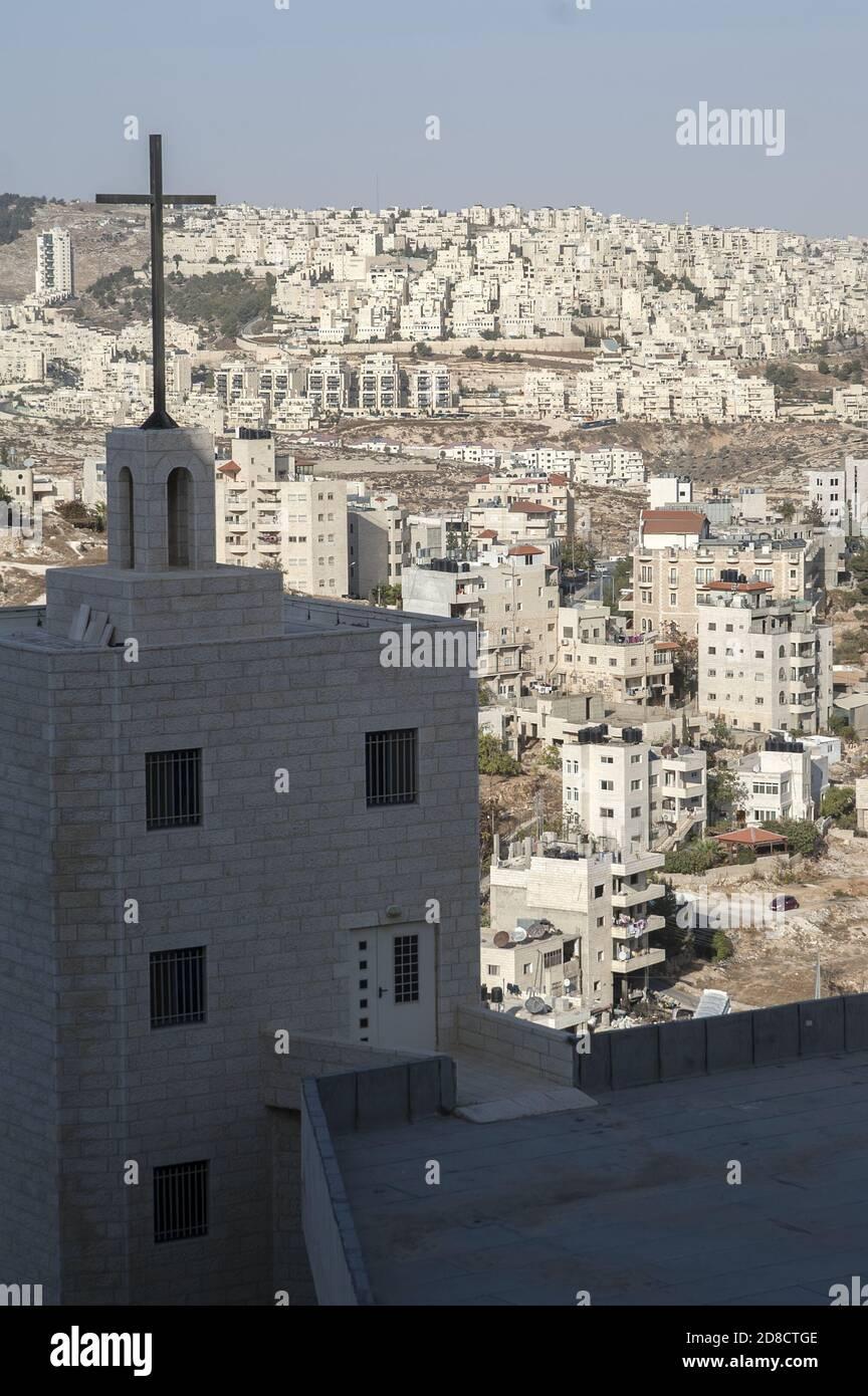 Bethlehem, בית לחם, Palestine, بيت لحم, Israel, Izrael, ישראל, Palestyna, دولة فلسطين; The cross against the background of Arab settlements. Stock Photo