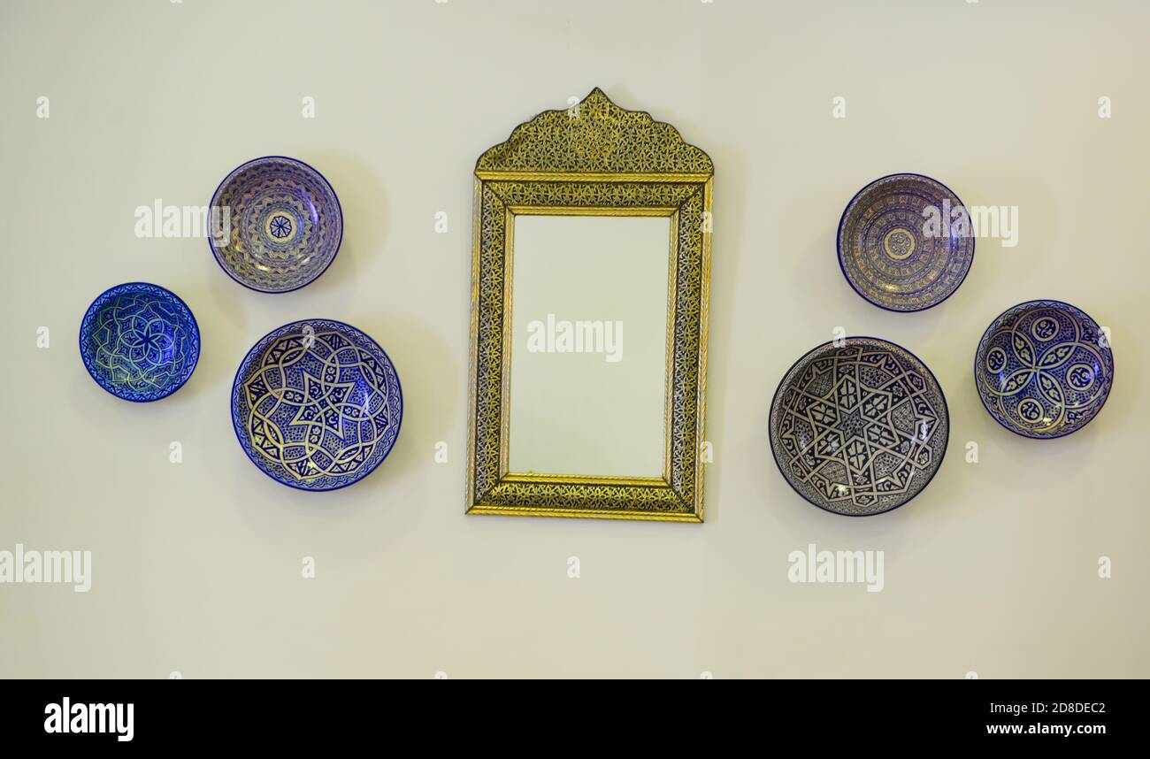 Moroccan Antiques Traditional Moroccan Plates And A Mirror Hanging On The Wall Stock Photo Alamy
