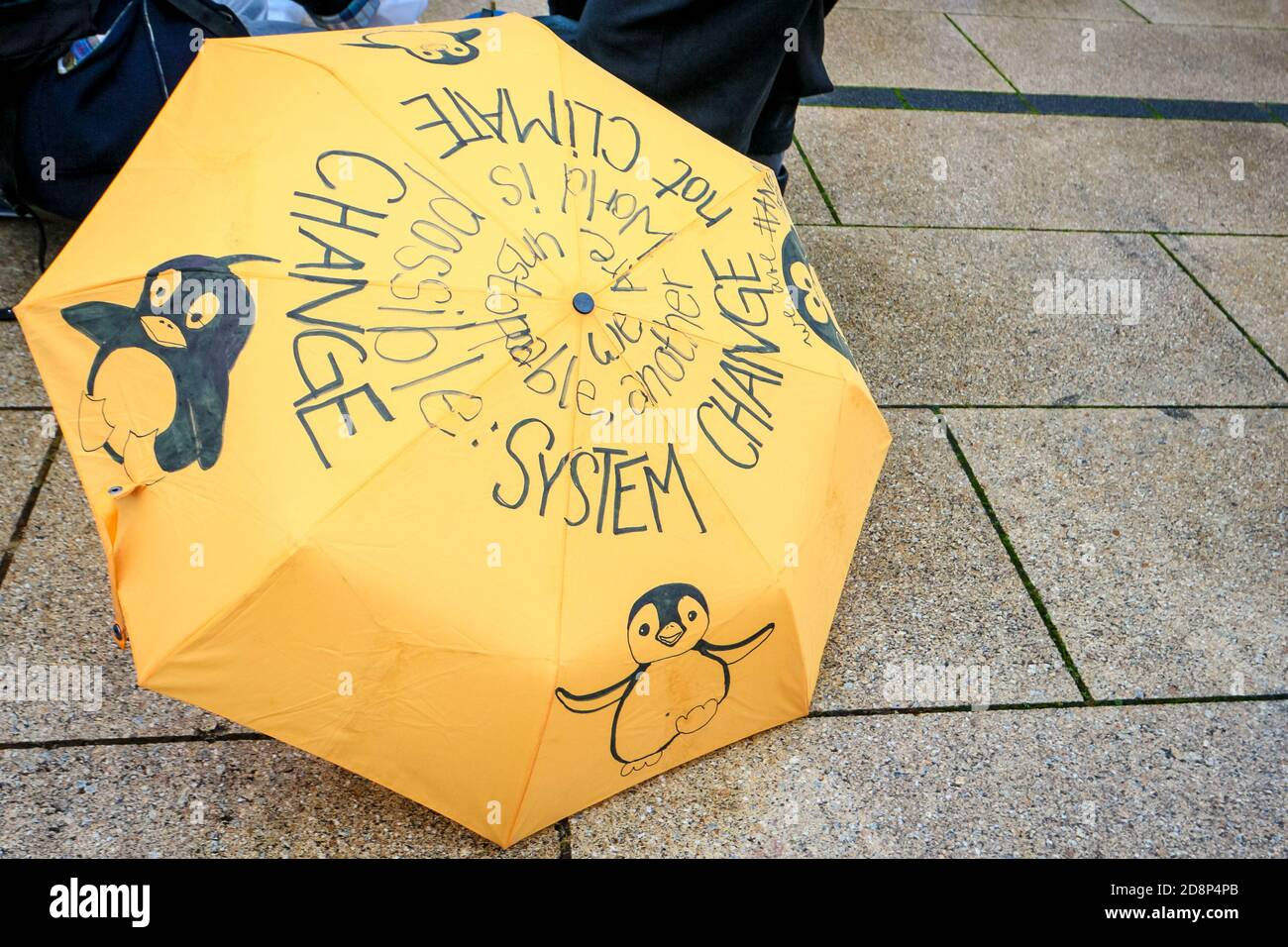 Placard umbrella as climate activists protest against the opening of new Berlin Brandenburg International Airport (BER). Stock Photo