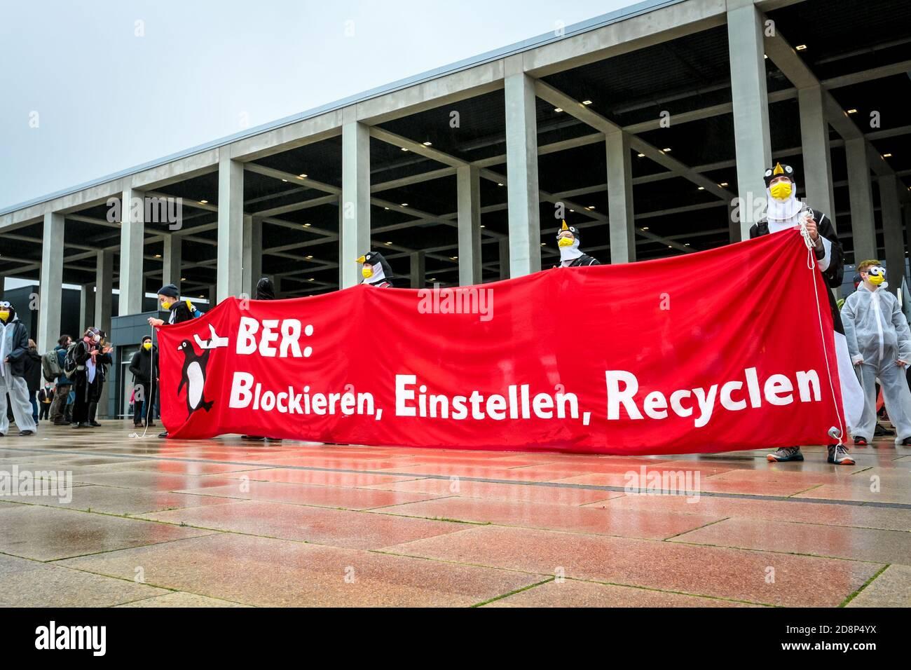 """BER: Blockieren, Einstellen, Recyclen"" sign as climate activists protest against the opening of new Berlin Brandenburg (BER) Airport. Stock Photo"