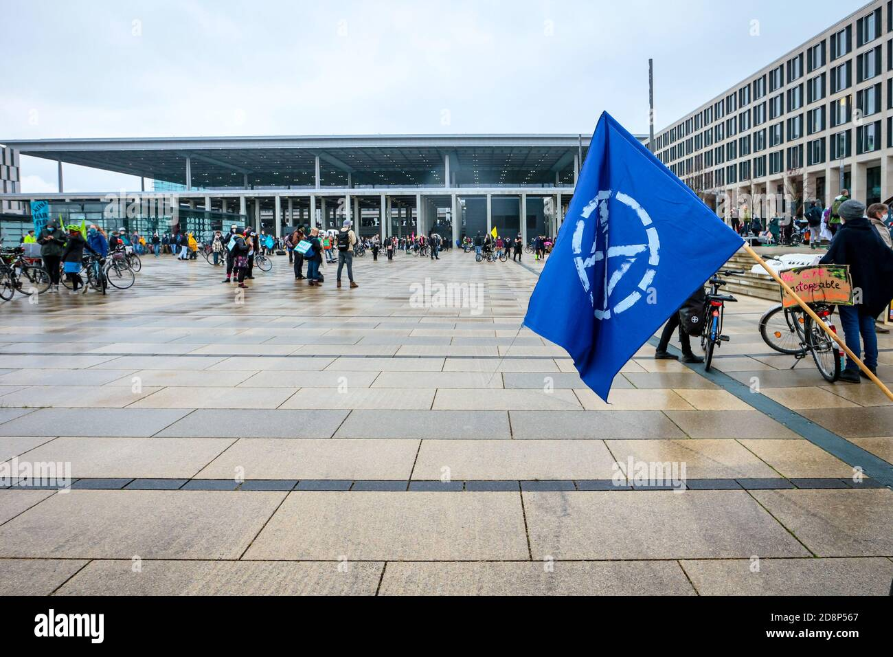 Extinction Rebellion flag as climate activists protest against the opening of new Berlin Brandenburg International Airport (BER). Stock Photo