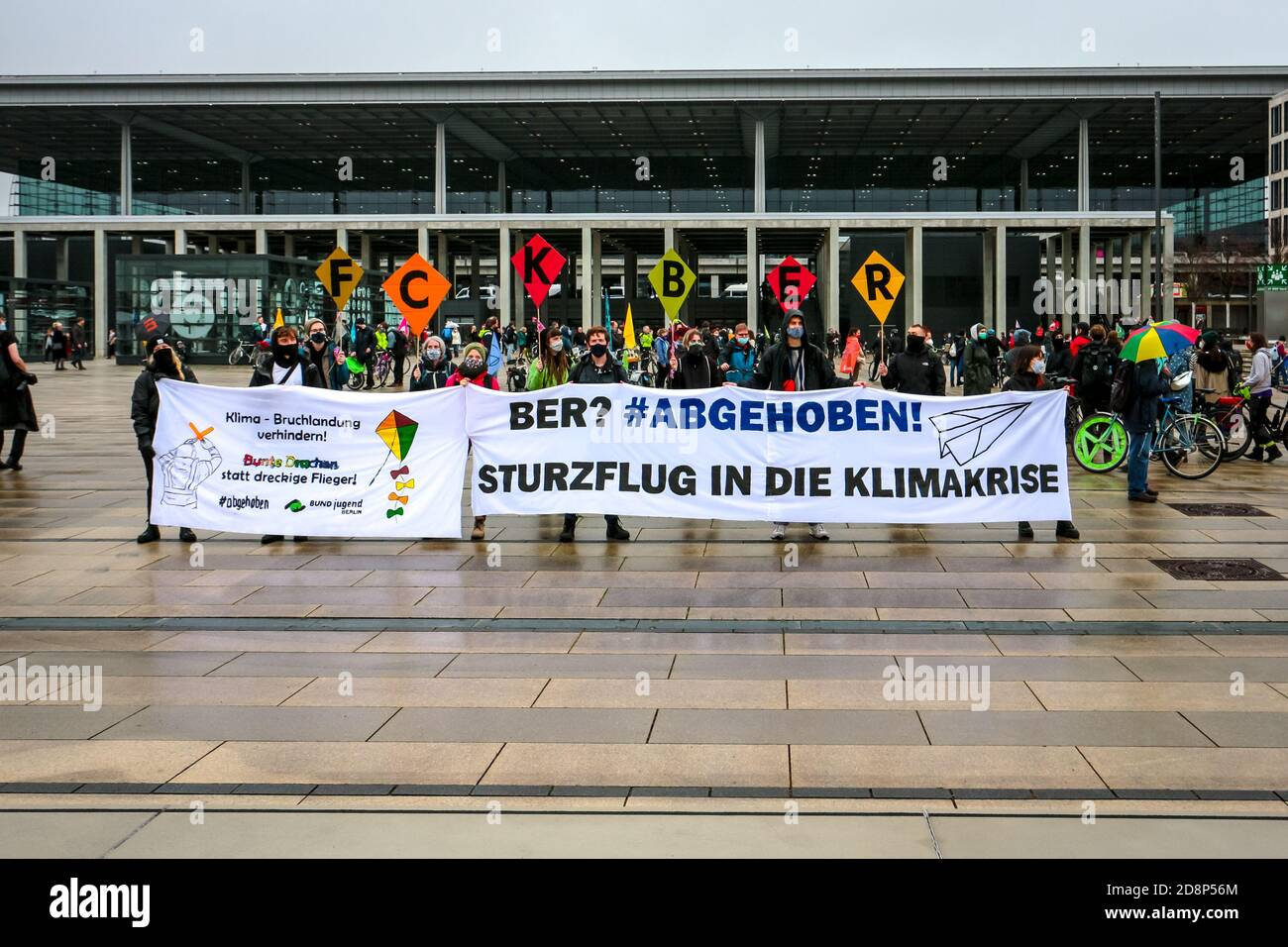 Climate activists protest against the opening of new Berlin Brandenburg International Airport (BER). Stock Photo