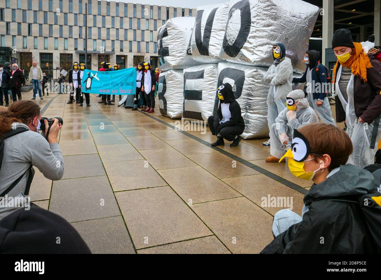 """Photographers take pictures of """"#NOBER"""" protest sign as climate activitists protest the opening of new Berlin Brandenburg International (BER) Airport. Stock Photo"""