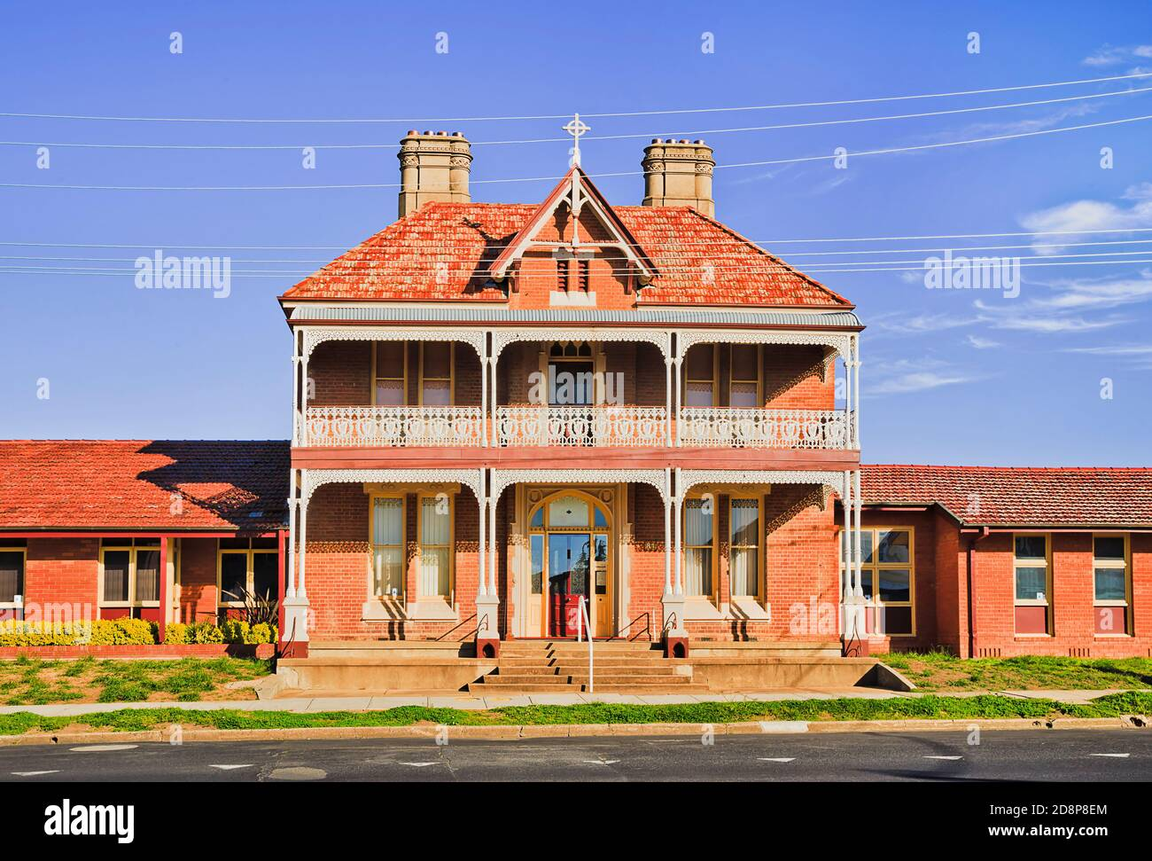 George street in Bathurst city of Australia - historic brick house facade along the road. Stock Photo