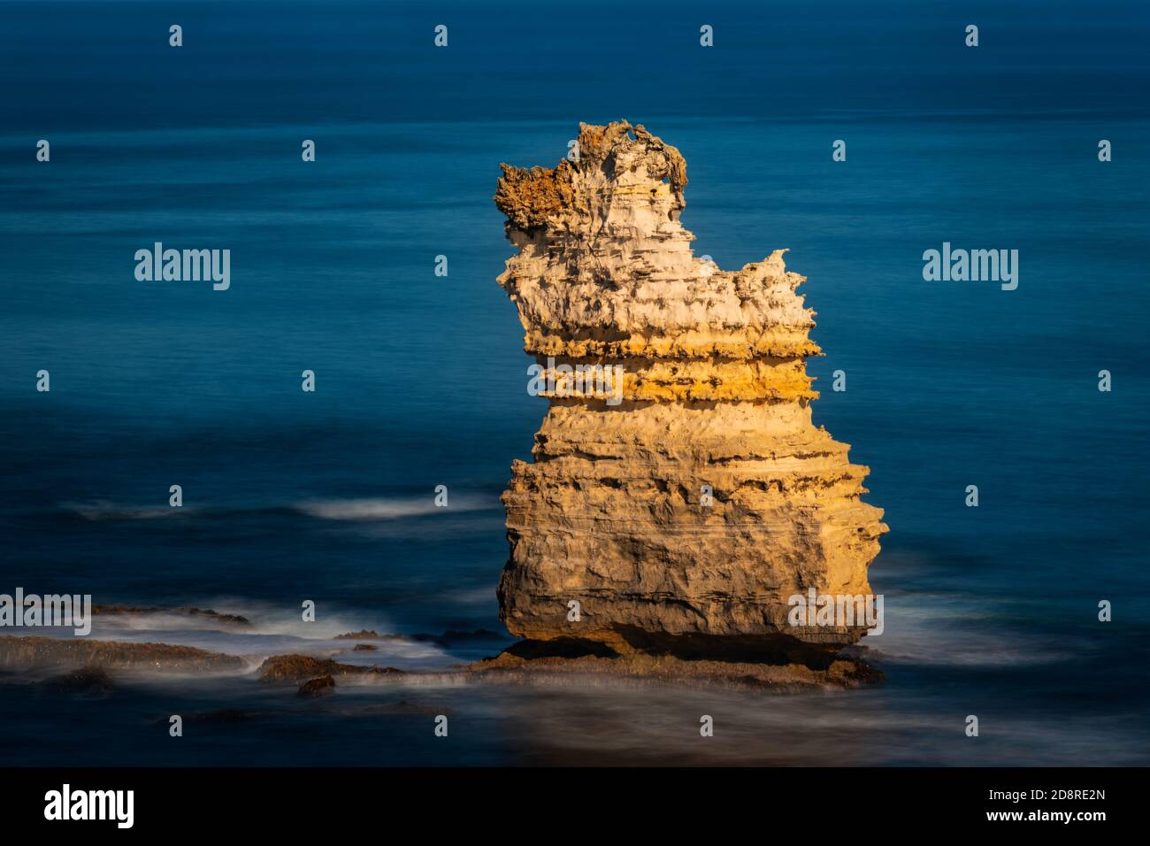 Lonely sea stack in Bay of Islands Coastal Park at the famous Great Ocean Road. Stock Photo