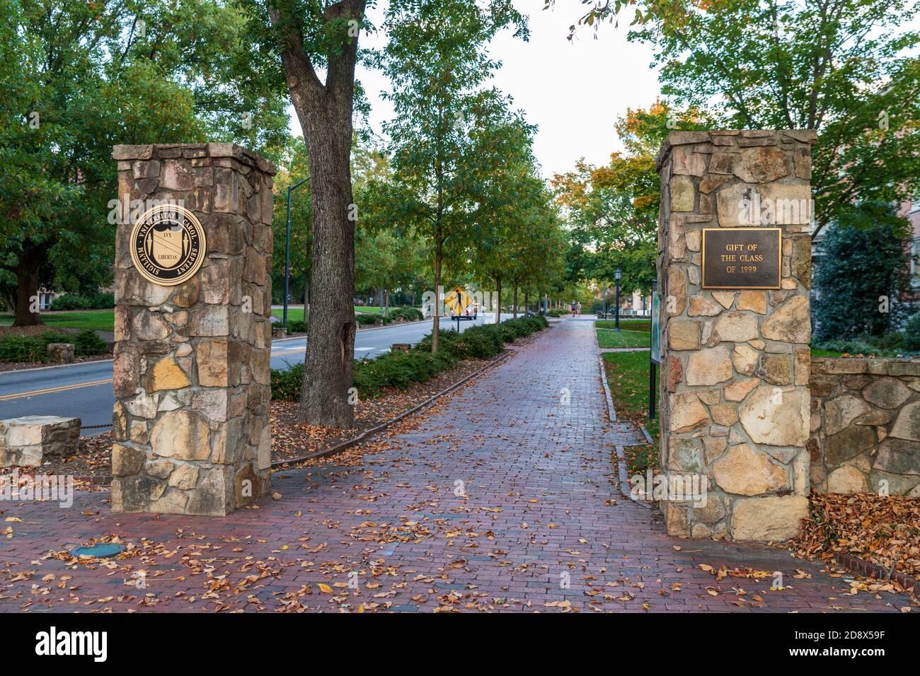 Chapel Hill, NC / USA - October 23, 2020: Stone entrance to the University of North Carolina Chapel hill with brick sidewalk Stock Photo