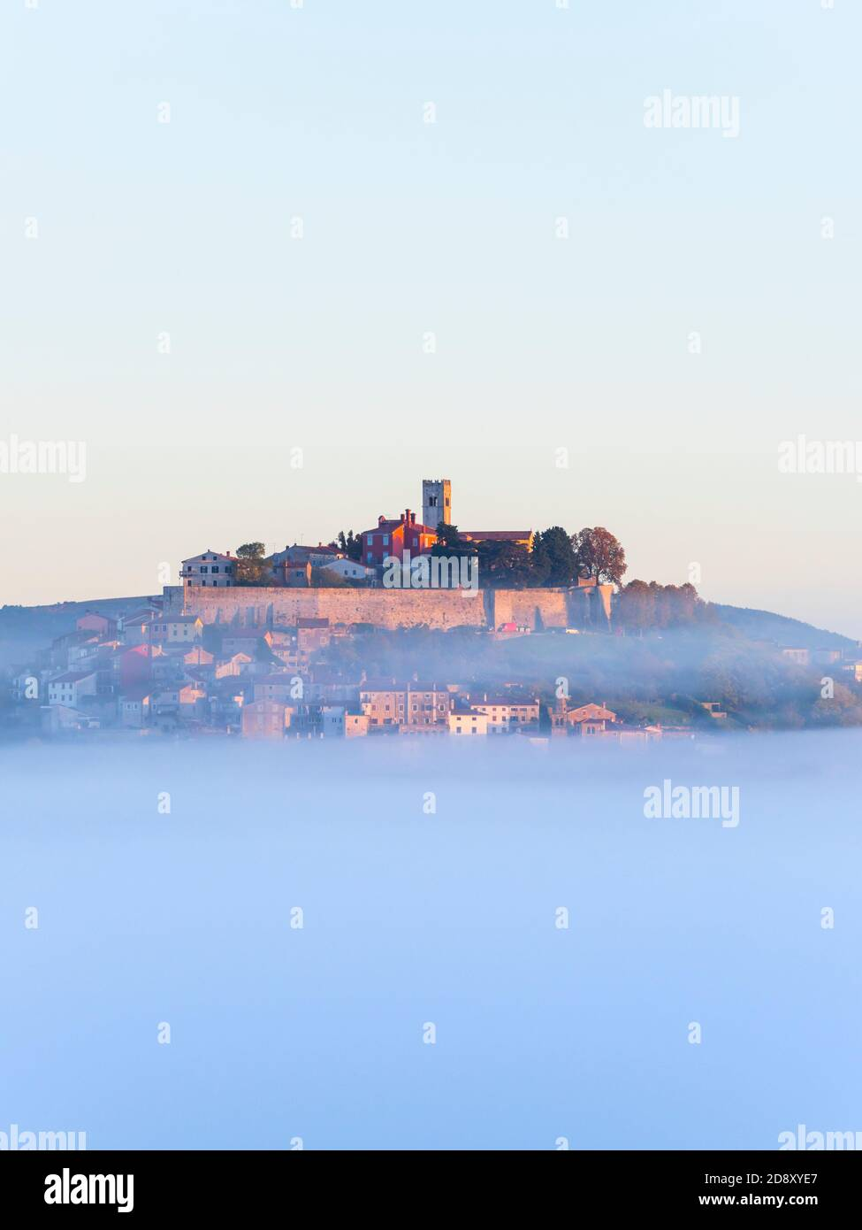 Like floating old town above thick fog stunning Motovun in Istria Croatia Europe in distance dreamy dreamland Stock Photo