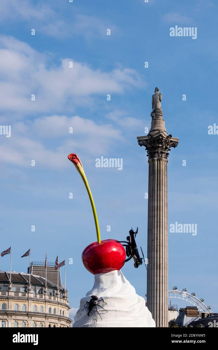 UK, London, Heather Phillipson's The End sculpture - a whipped cream sundae topped with a giant fly melting on Trafalgar Square's fourth plinth. 2020 Stock Photo