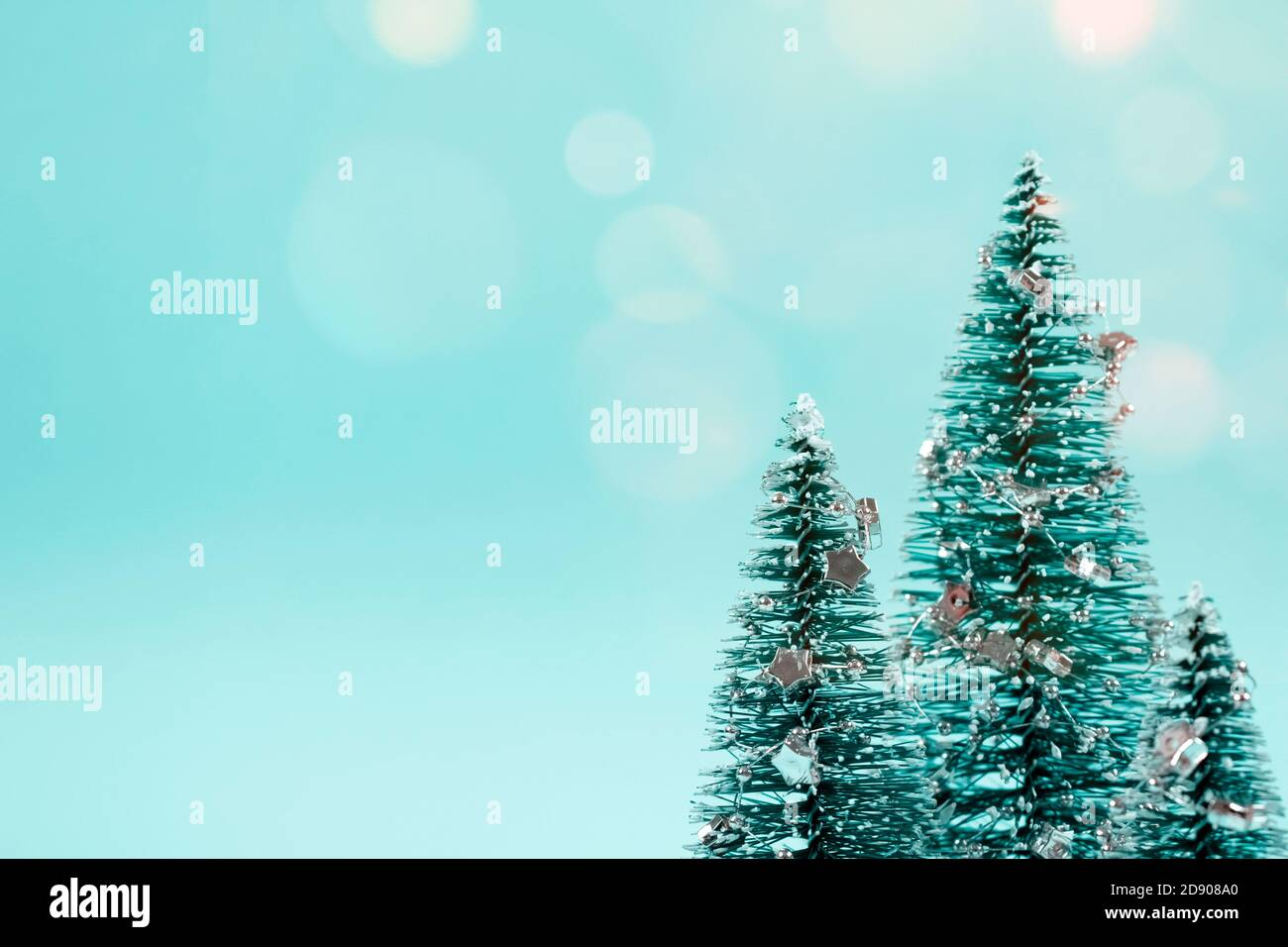 Trendy Christmas Background In Pastel Mint Colour Christmas Tree Or New Year Tree With Decorations And Bokeh Lights On Green Background With Stock Photo Alamy