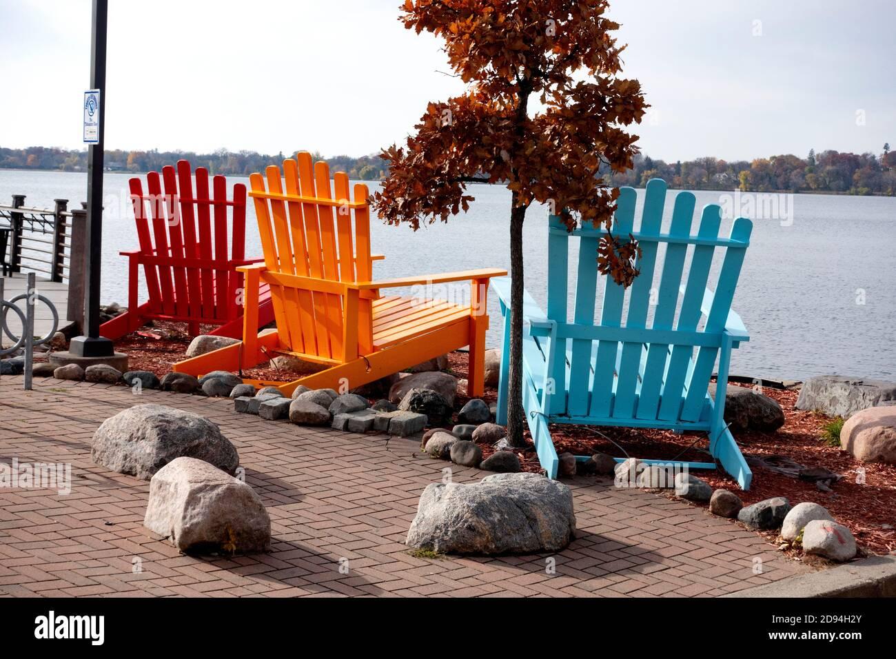 Jumbo colorful Adriatic chairs overlooking Lake Bde Maka Ska. Minneapolis Minnesota MN USA Stock Photo