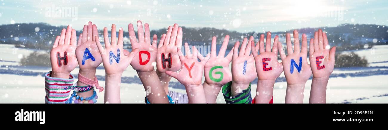Kids Hands Holding Word Handhygiene Mean Hand Hygiene, Snowy Winter Background Stock Photo