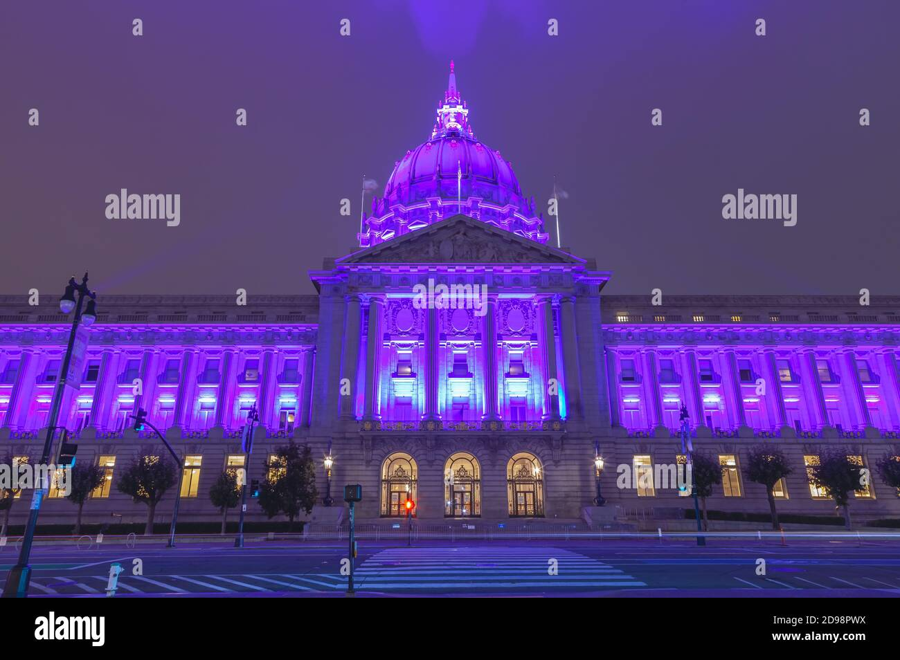 San Francisco City Hall lights up in purple to honor the country hospitality industry, California, USA. Stock Photo
