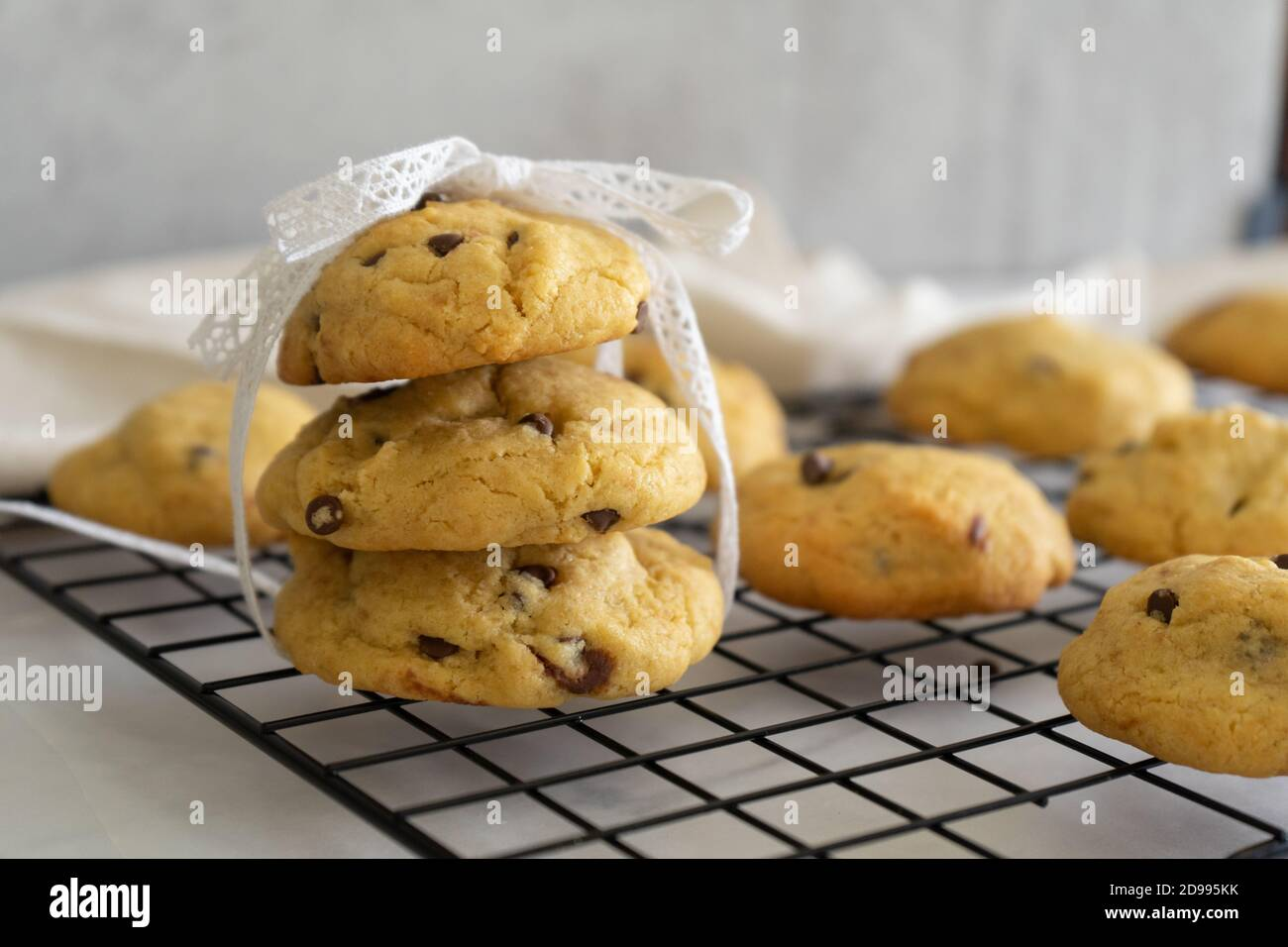 Homemade stack of chocolate chip cookies on white background. Baked goods. Stock Photo