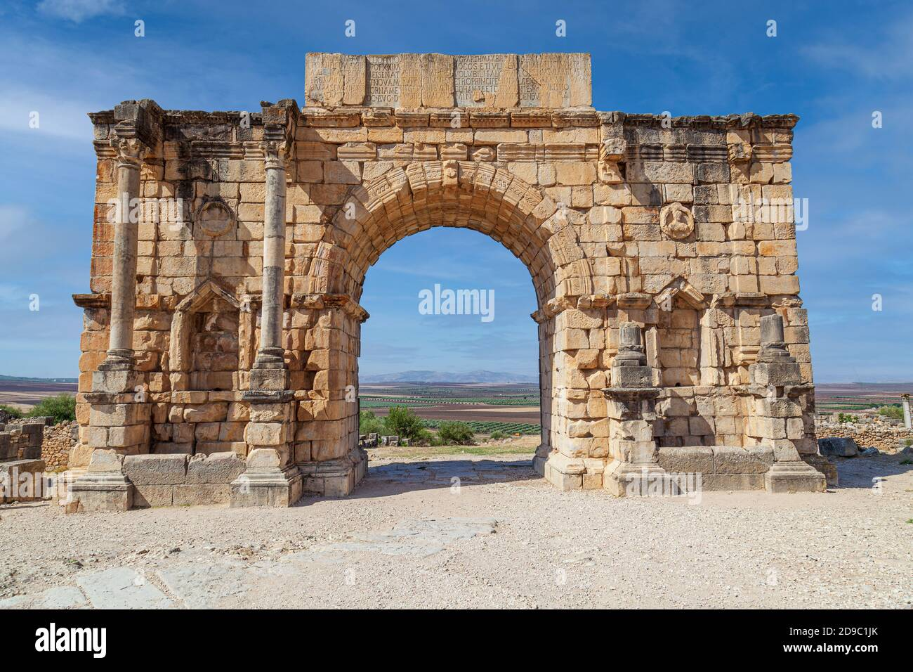 The Triumphal Arch devoted to Emperor Caracalla at the 3rd Century Ruins at Volubilis morocco Stock Photo