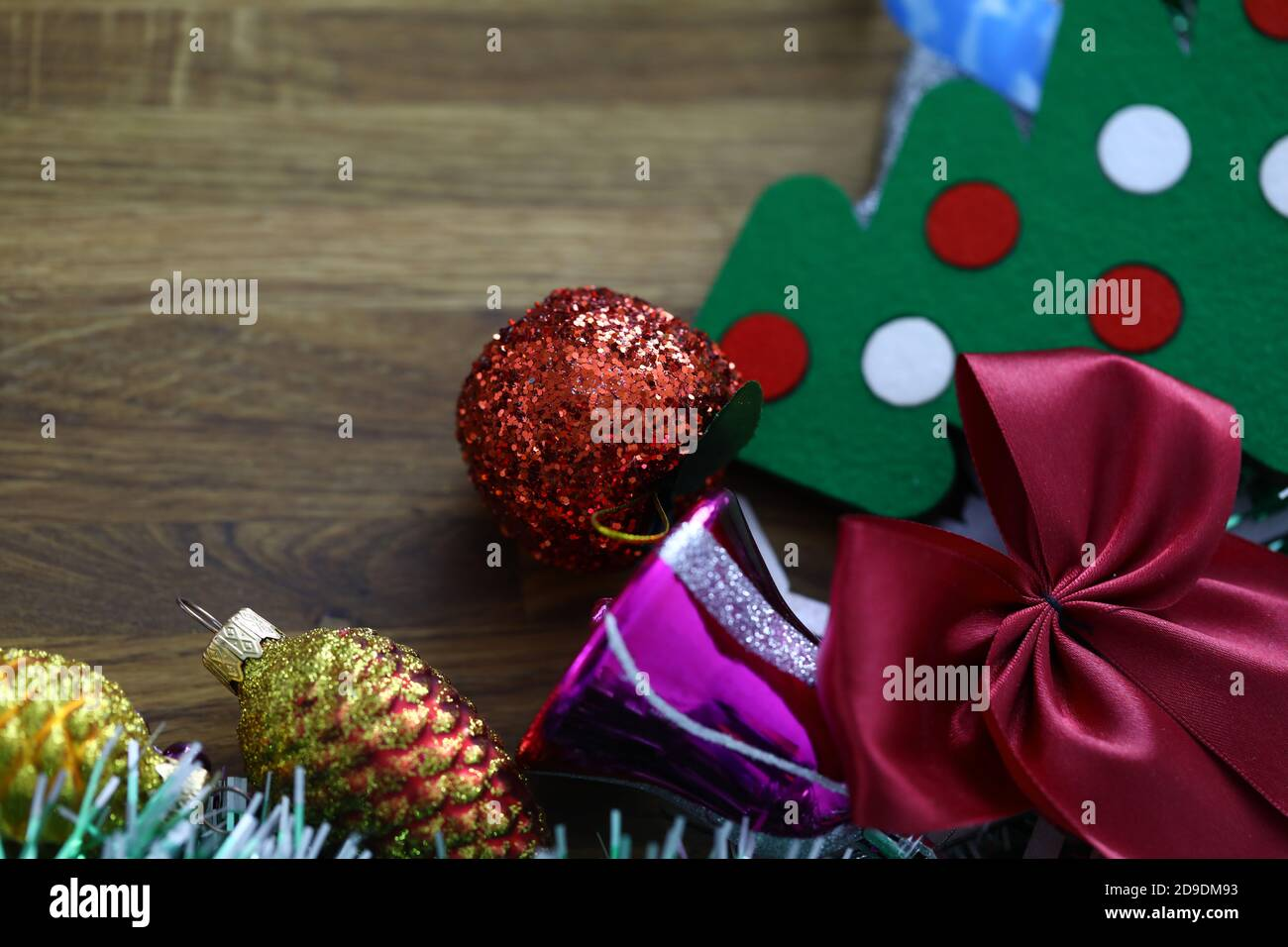 New Year S Decorations And Small Christmas Tree Lies On Table Stock Photo Alamy
