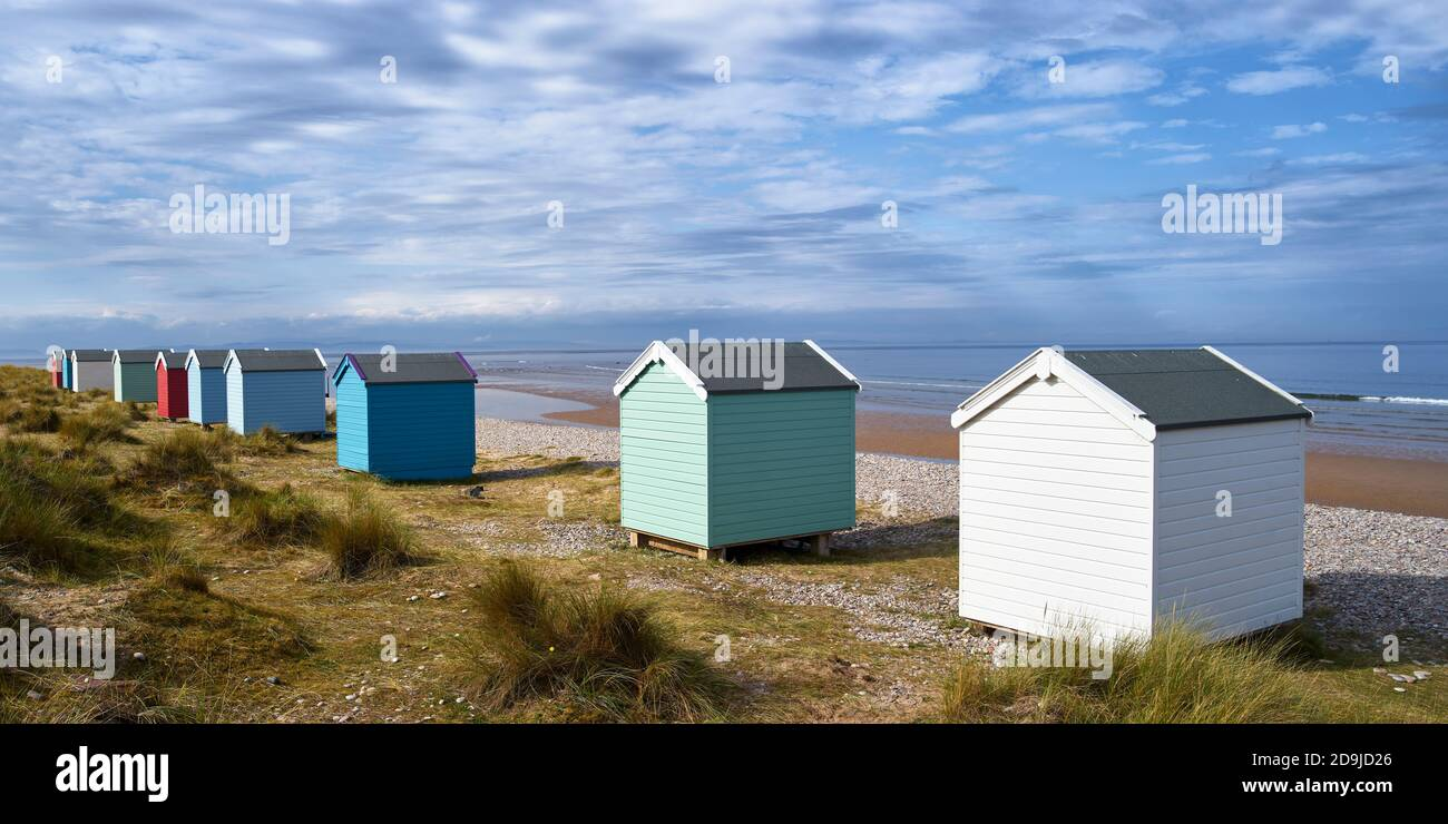 Colouful beach huts at Findhorn beach, Moray, Scotland.  Panoramic Stock Photo