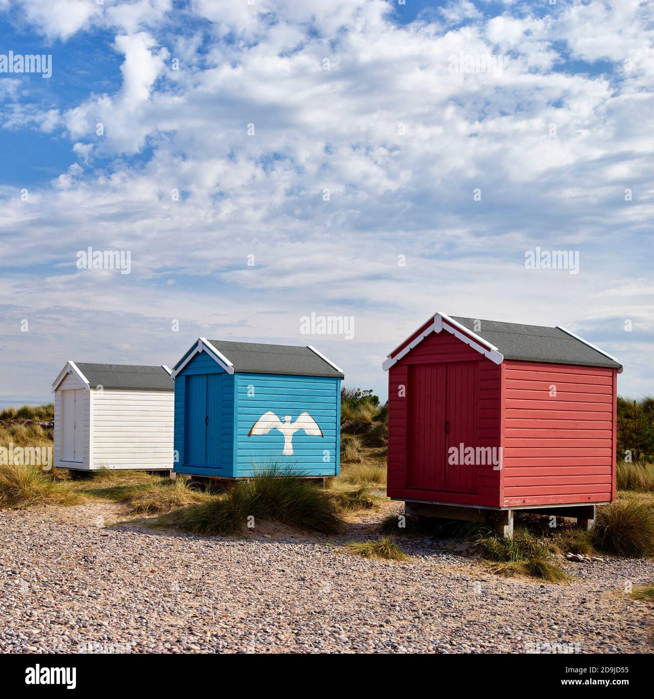 Colouful beach huts at Findhorn beach, Moray, Scotland. Stock Photo