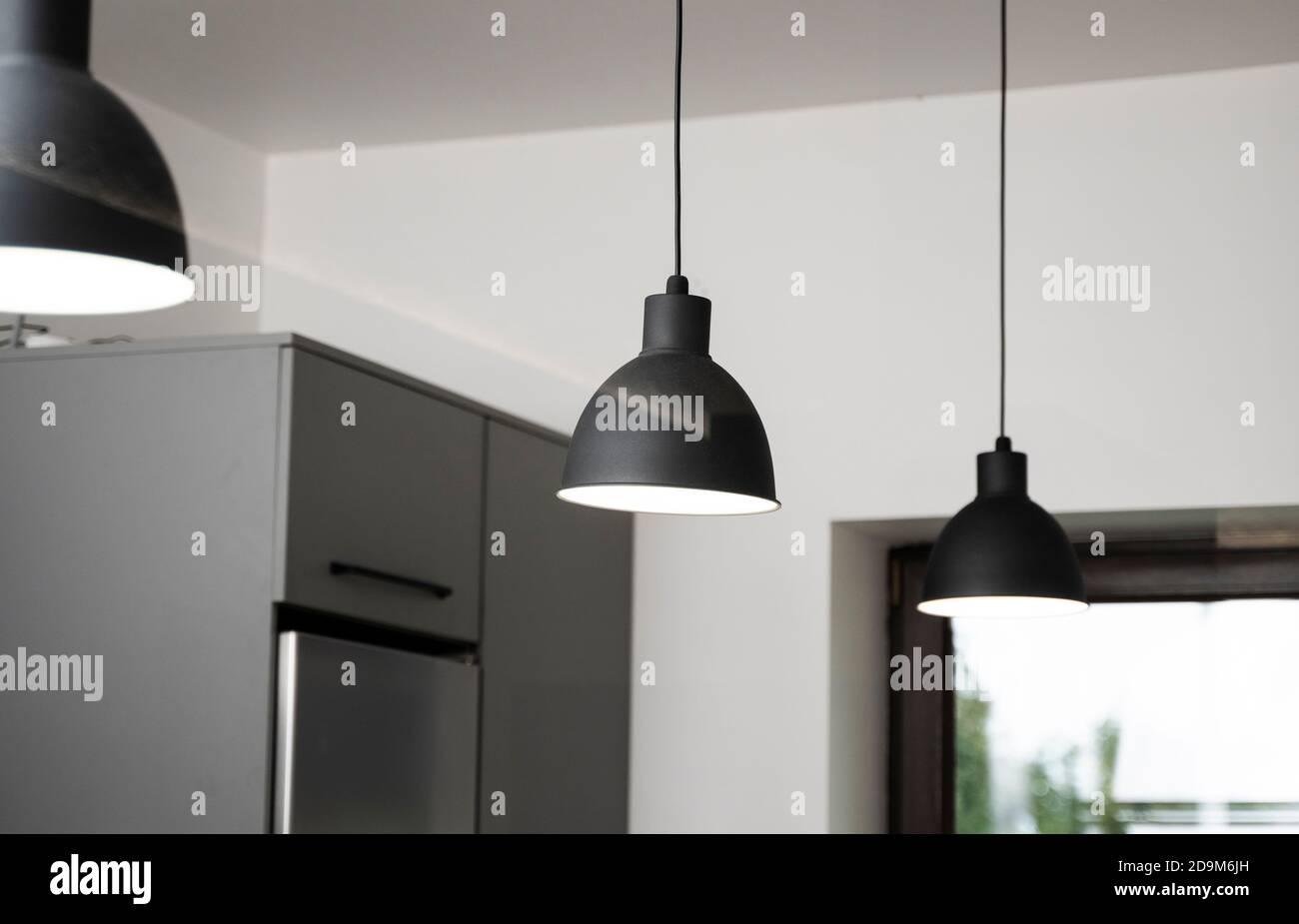 Industrial Black Look Pendant Lamps In A Kitchen Interior Modern Loft Interior Design Stock Photo Alamy
