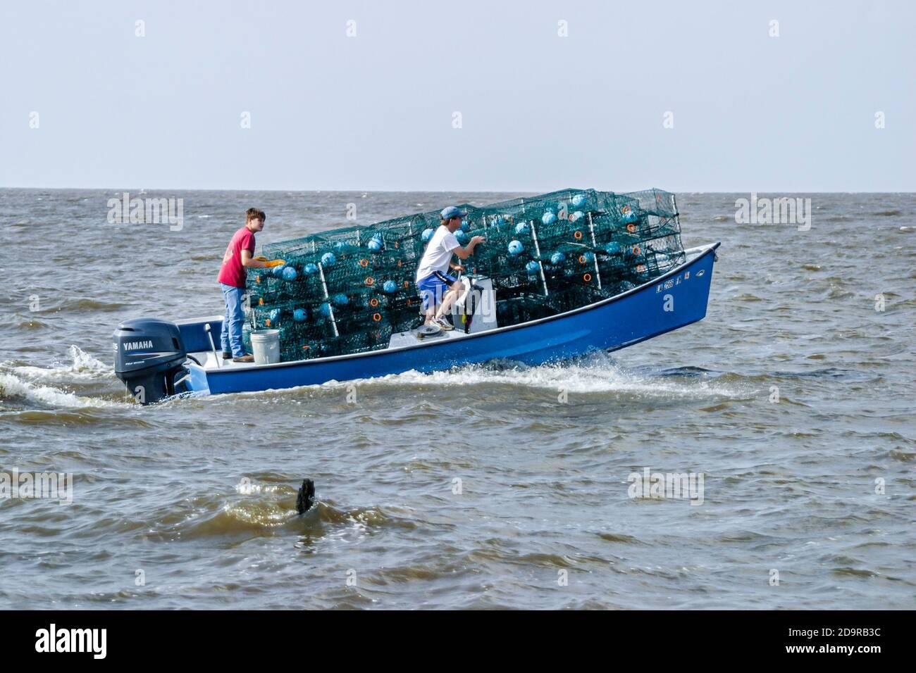 Louisiana Lake Pontchartrain Saint St. Tammany Parish Madisonville, boat loaded full filled crab traps, Stock Photo