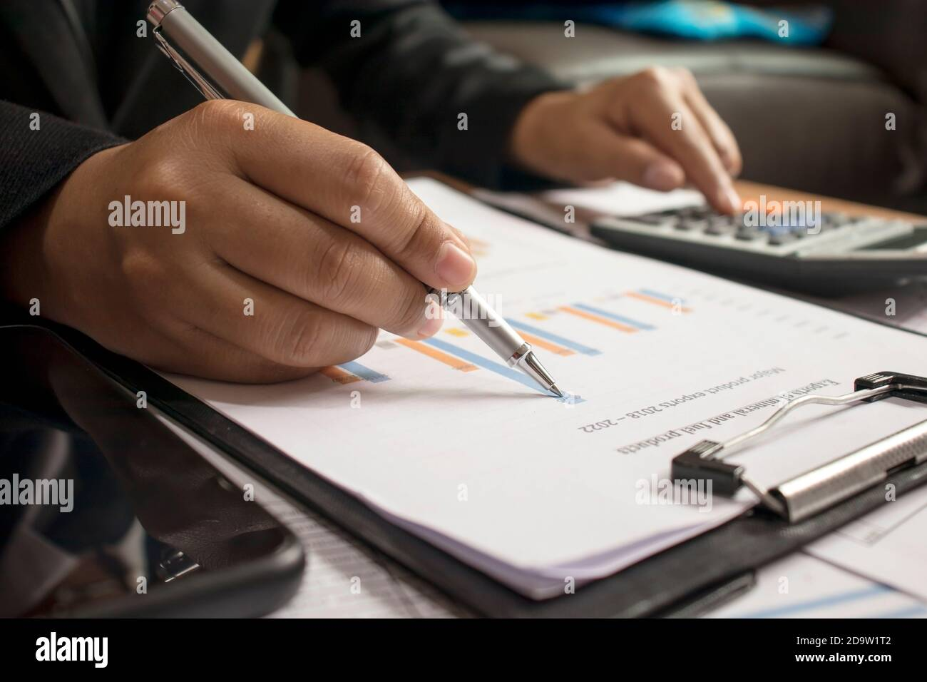 Business people reviewing reports, financial documents for analysis of financial information, work concept. Stock Photo