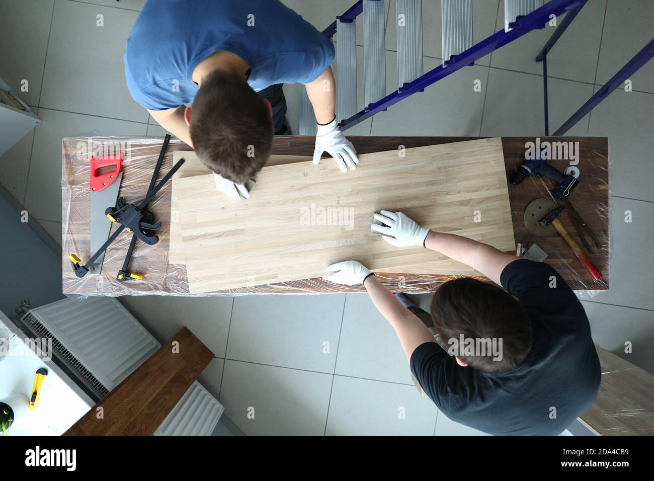 Woodworkers in uniform at workplace Stock Photo