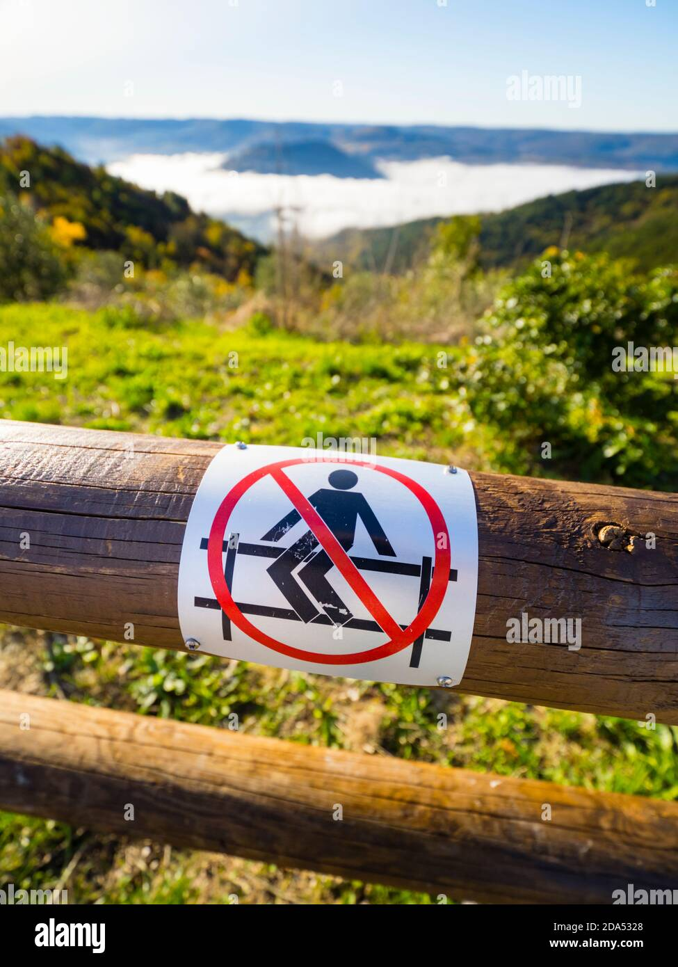 Dont cross over sit sitting seated wooden fence mark sign warning sticker sightseeing place before Oprtalj near Moscenice in Istria in Croatia Europe Stock Photo