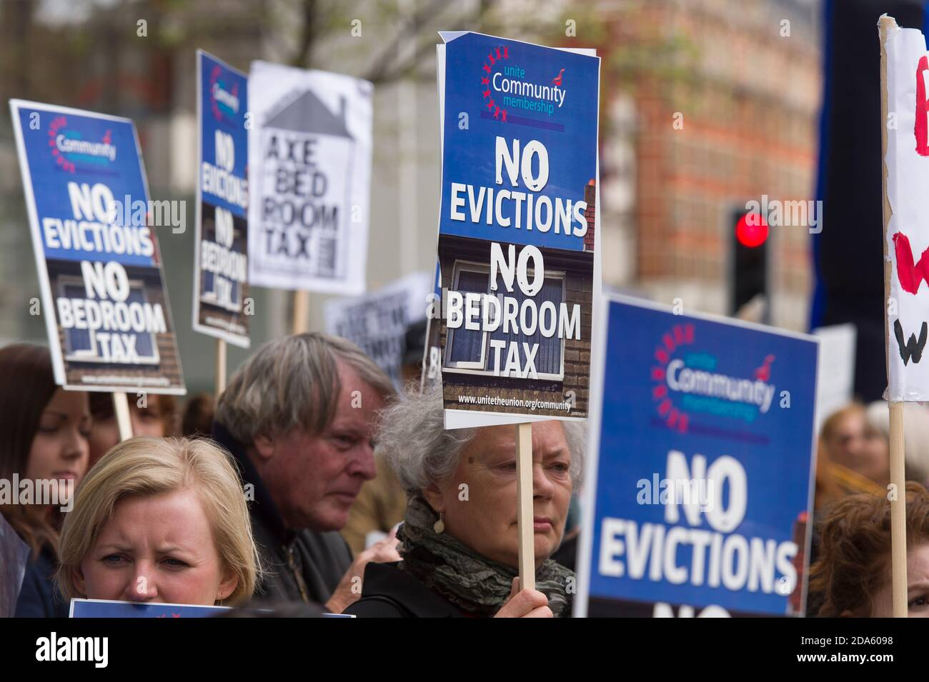 """Protest to mark the first anniversary of the 'Bedroom Tax', outside One Hyde Park, one of London's most expensive residence. The Welfare Reform Act 2012, which came into force on 1 April 2013 included changes housing benefit rules. These changes include an """"under-occupancy penalty"""" which reduces the amount of benefit paid to claimants if they are deemed to have too much living space in the property they are claiming housing benefit on, these changed became know as the 'Bedroom Tax'.  One Hyde Park, Knightsbridge, London, UK.  5 Apr 2014 Stock Photo"""